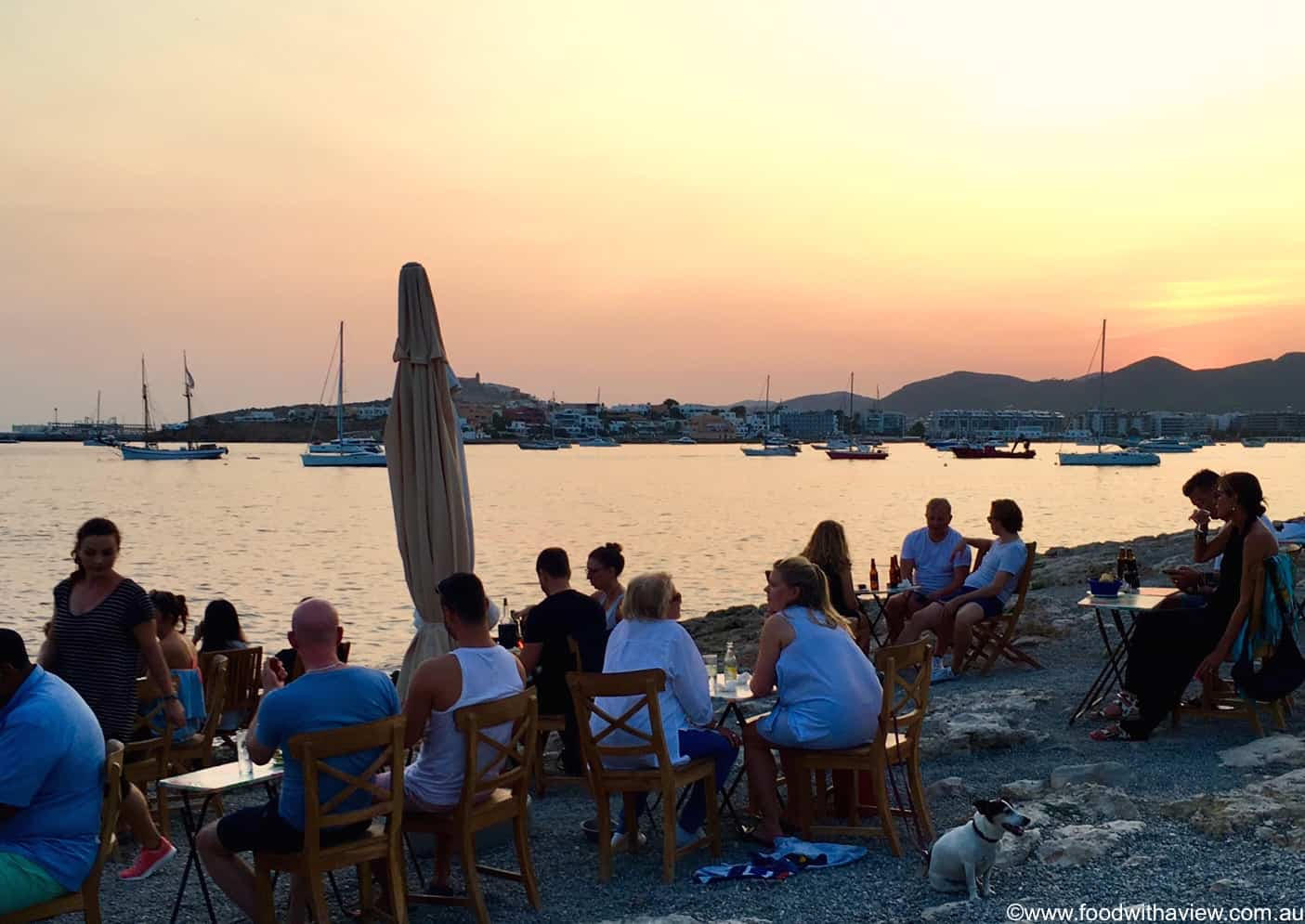 enjoy Ibiza seafood and evening sunset over the Fish Shack